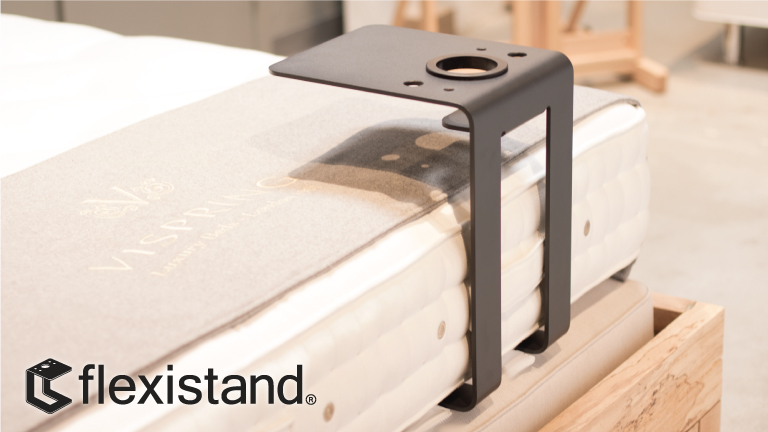 Flexistand holds laptops, books or dinner in bed.